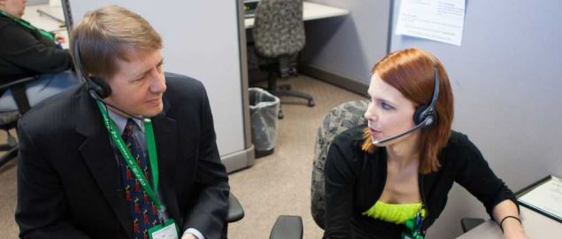 CFPD Director Richard Cordray speaking with a worker at a call center in Iowa