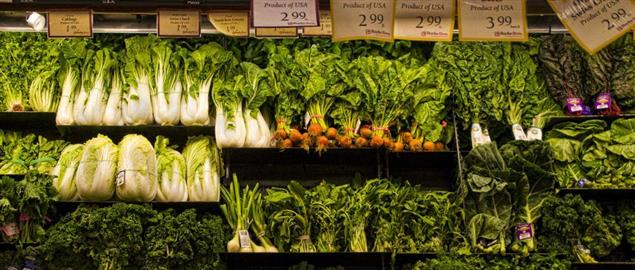 Vegetables on shelves in a grocery store