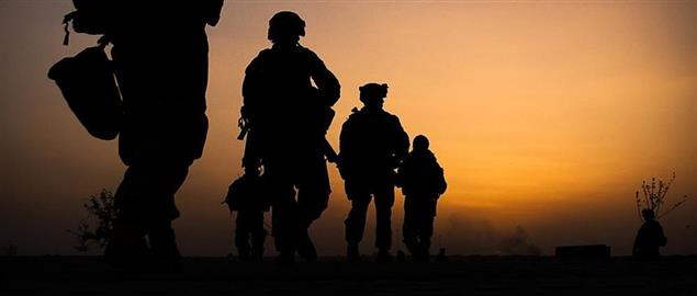 Marines conducting a dawn patrol in Nawa District, Afghanistan