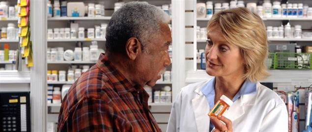 Man Consults with a Pharmacist