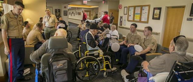 U.S. Marines visiting with residents at a nursing home in Florida