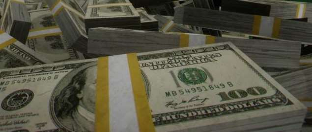 A close-up of a large stack of US $100 dollar bills in wrappings